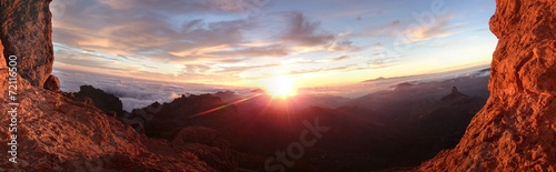 Photo Stands Brown Fiery sunrise over a mountain landscape