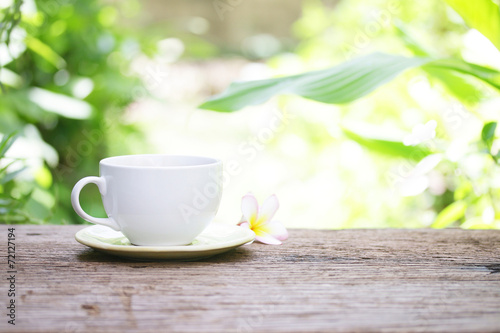 Wall Murals Cafe coffee in white cup on wooden table