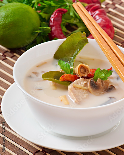Photo  Thai soup with chicken and mushrooms