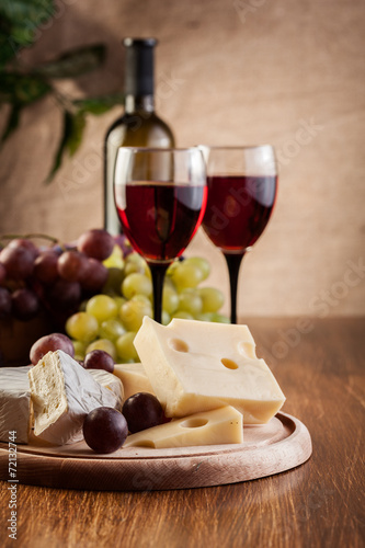 Vászonkép Cheese with a bottle and glasses of red wine