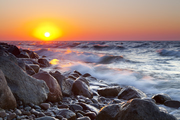 Panel SzklanyThe pebble beach at sunset - Rozewie, Poland, long exposure