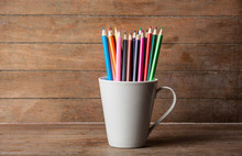 Color Pencil In Cup On A Woode...