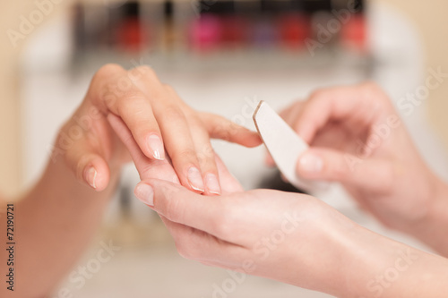 Fotografie, Obraz  Woman in nail salon receiving manicure.