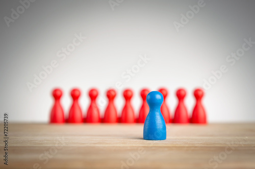 Poster  Stand out and be unique - leadership business concept with pawns