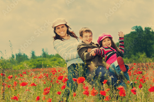Fényképezés  Vintage family on the poppy meadow