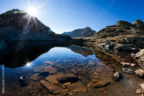 Small mountain lake in a sunny autumn day in italian Alps Canvas Print