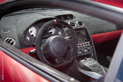 Photo  Exotic sportscar interior in suede leather and carbon fiber