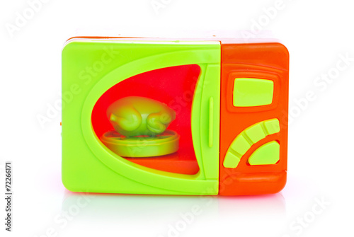 Plastic toy microwave on the white background