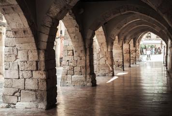 Fototapeta Old stone archway. Street of Tarragona, Spain