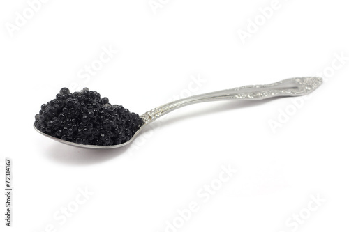 black caviar in metal spoon on a white background