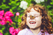 canvas print picture - Laughing girl with a butterfly on his nose.