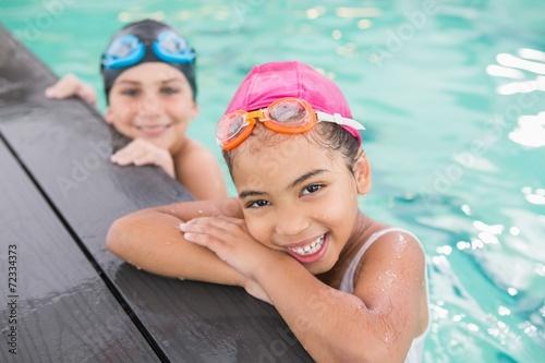 Slika na platnu Cute swimming class in the pool
