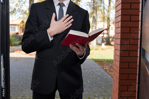 Fotografie, Obraz  Jehovah's witness standing at the door