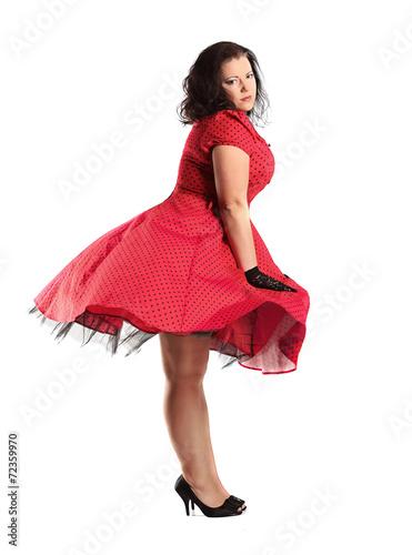 Photo  portrait of beautiful plus size brunette in polka dot dress