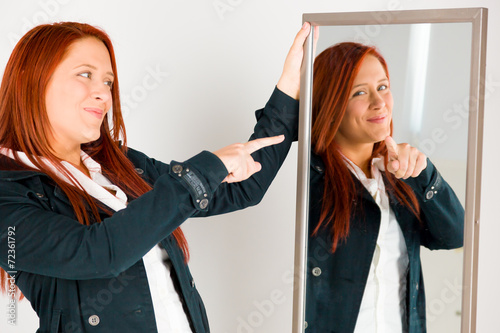 Fotografie, Obraz  model isolated on plain background pointing to herself