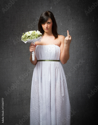 Photo wedding rude gesture with middle finger