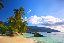 Tropical Beach With Palms And Rocks In Mahe Island, Seychelles