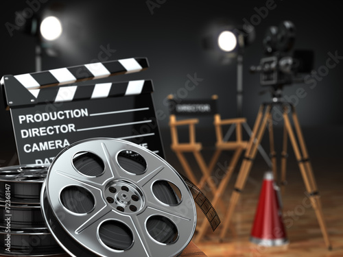 Video, movie, cinema concept. Retro camera, reels, clapperboard #72368147