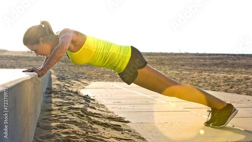 Fotografie, Obraz  Woman doing Press ups on a beach