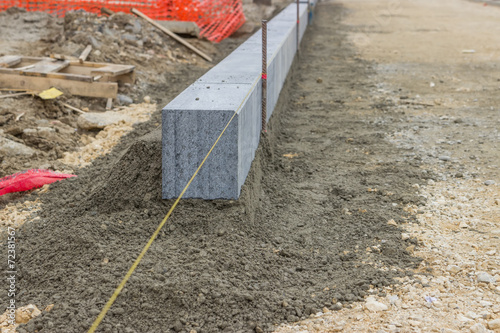 Large grey granite curb stone - Buy this stock photo and