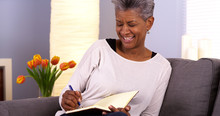Mature Black Woman Writing In Journal