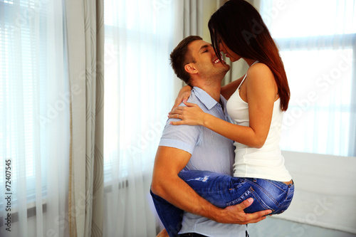 Fotografie, Obraz  Beautiful couple in passionate embrace at home