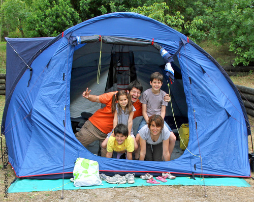 Foto op Canvas Kamperen happy family of five in the tent camping