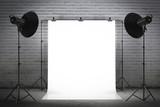 Professional strobe lights illuminating a backdrop - 72408716