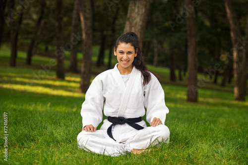 Young woman practicing judo portrait outdoors in a park. Canvas Print