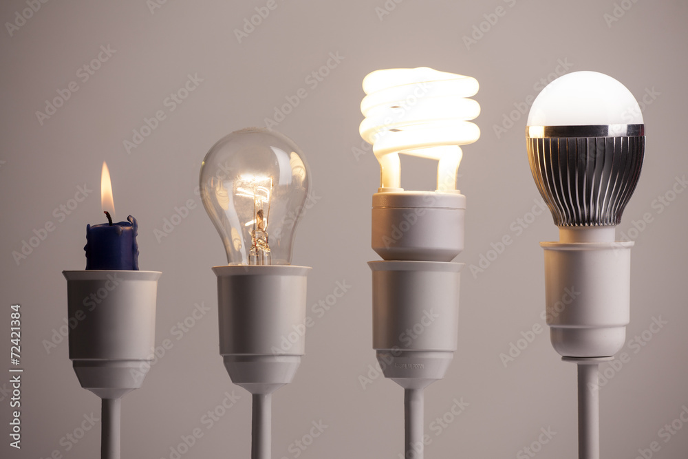 Fototapety, obrazy: Progress of lighting with candle, tungsten, fluorescent and LED