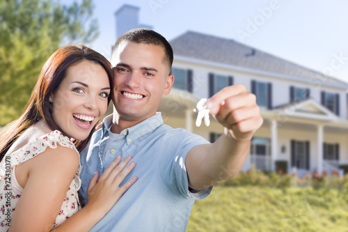 Fotografie, Obraz  Military Couple with House Keys In Front of New Home