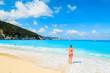 Woman standing on beautiful Myrtos beach on Kefalonia island