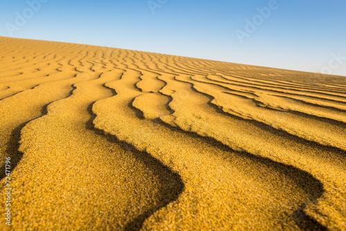 Fotografia  Sand waves at sunset, beach of Maspalomas, Gran Canarias