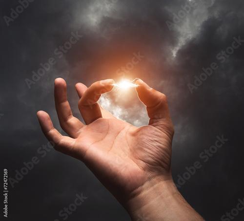 Fotografie, Obraz  Lightning between two fingers