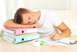 Tired man with many folders sleeps on table
