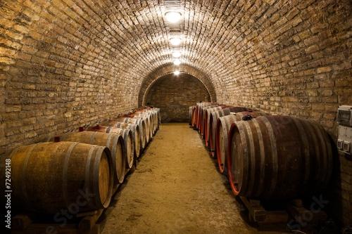 Fotografia  Barrels in a hungarian wine cellar