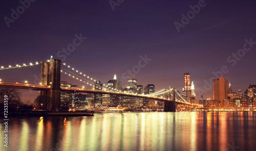 Colorful night skyline of downtown New York, New York, USA.