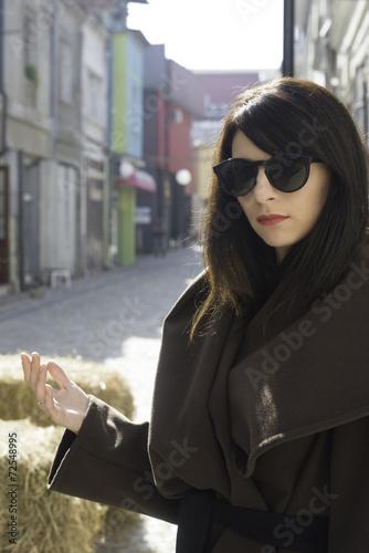 Photo Girl in brown wool jacket