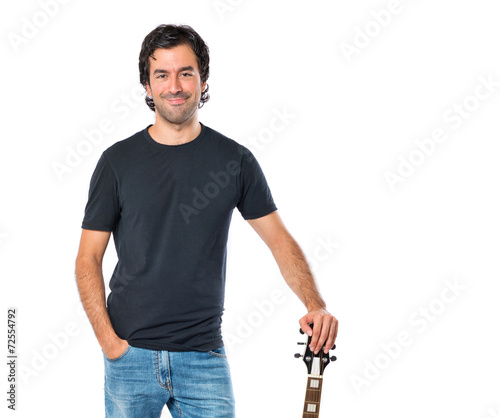 In de dag Art Studio Handsome man with guitar over white background