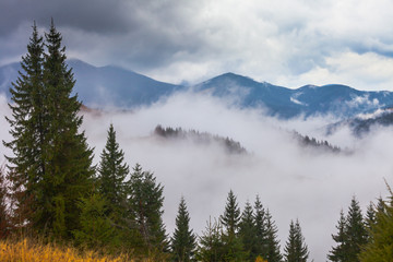 Obraz global warming. mountain landscape. Clouds and fog