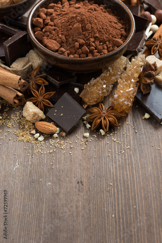 Foto op Plexiglas Chocolade spices for hot chocolate on a wooden background, vertical