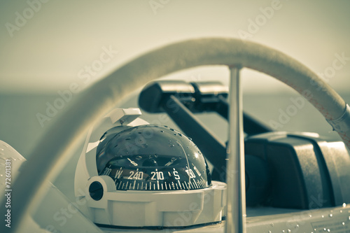 Photo  Sailing yacht control wheel and implement. Horizontal shot witho