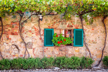 Fototapeta Uliczki Beautiful porch decorated with flowers in italy