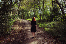 Young Woman Walking In Forest
