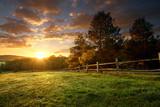 Fototapeta Fototapety z naturą - Picturesque landscape, fenced ranch at sunrise