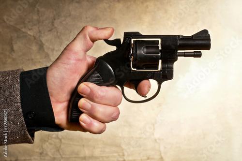 Fotografia, Obraz  hand holding a hangun