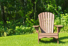 Adirondack Summer Lawn Chair Outside On The Green Grass
