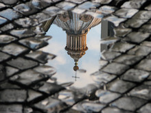 Rome Church Dome In A Puddle Reflection