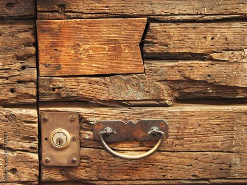 Fotografie, Obraz  Maniglia su porta di legno