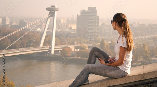 Photo  girl sitting over Bratislava